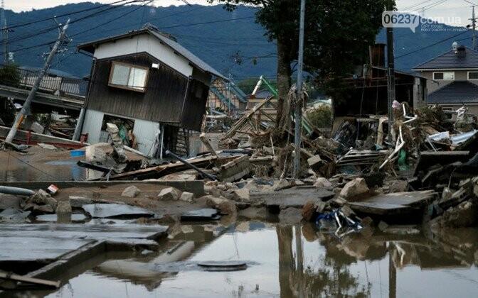 Число жертв наводнений в Японии превысило 200 человек, фото-1
