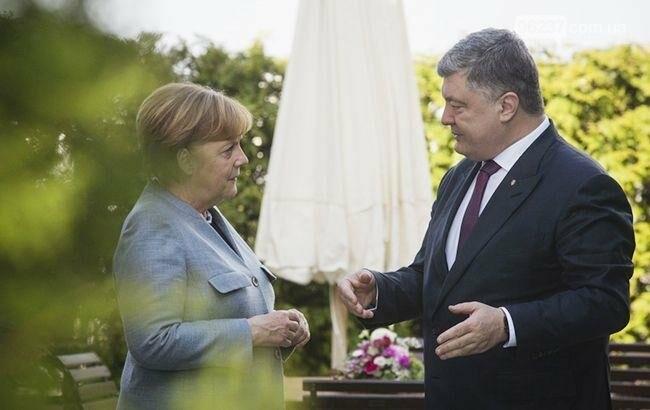Меркель проинформировала Порошенко о результатах переговоров с Путиным, фото-1
