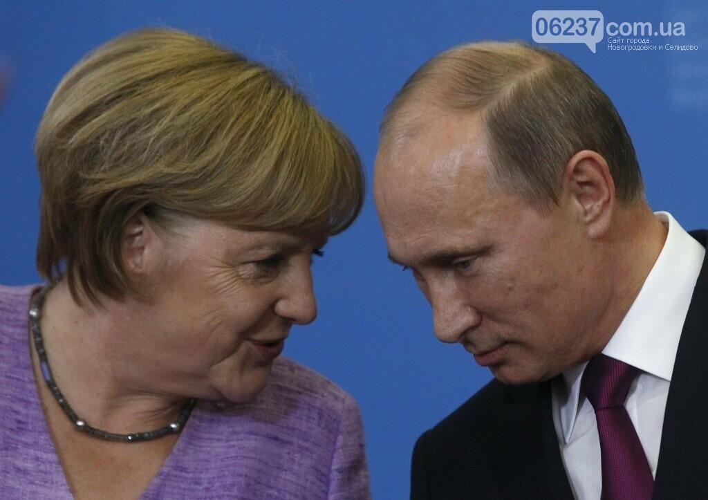 Меркель с Путиным говорили о политзаключенном Сенцове, фото-1
