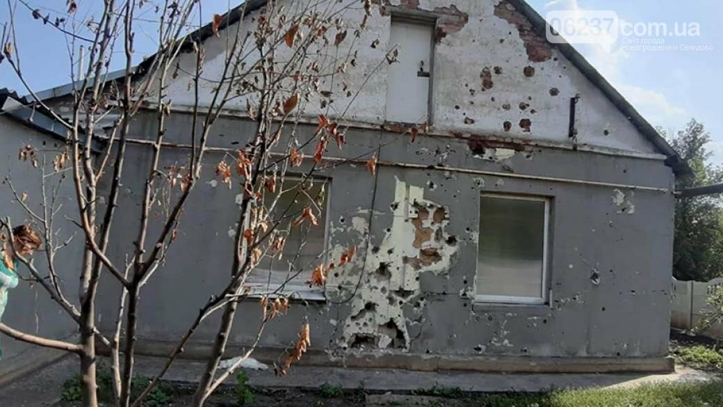 Впервые за 5 лет: в поселке под Донецким аэропортом начались ремонтные работы, фото-1